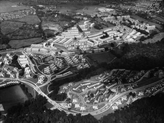 Figure 4:  Newfield Green (Gleadless Valley) in the late 1960s.  This estate was built across very steeply sloping fields incorporated former field boundaries and mature woodlands. The dwelling types where chosen for their suitability to individual topographic locations. © Aerofilms / English Heritage National Monuments Record.