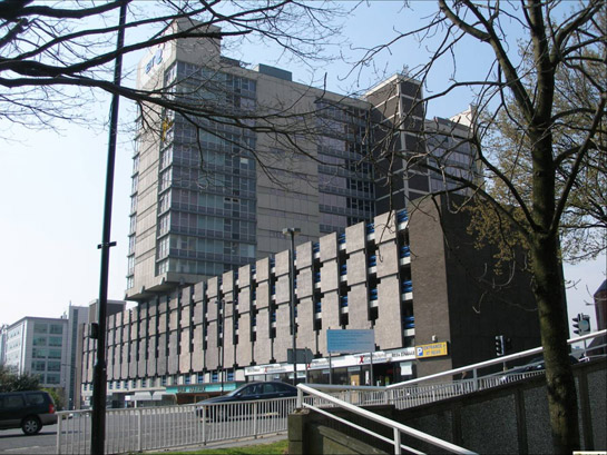 Text Box: Figure 1: Telephone House, built in 1972 above a brutalist inspired car park is typical of the architecture originally built around the 20th century urban dual carriageways of this zone.