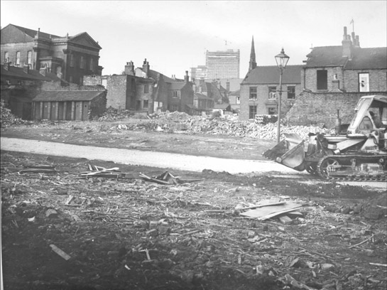 Figure 7: Demolition of Aberdeen Street in Broomhall in advance of the construction of the inner ring road and Hanover Estate in 1964 – note the half built University Arts Tower in the background © SCC