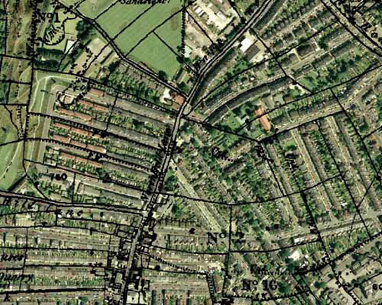 Historic OS mapping overlaid on a modern aerial photograph, showing earlier field boundaries reflected in many later street patterns